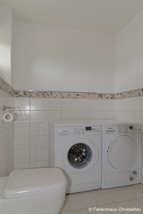 Wheelchair accessible bathroom on the ground floor with washing machine + dryer
