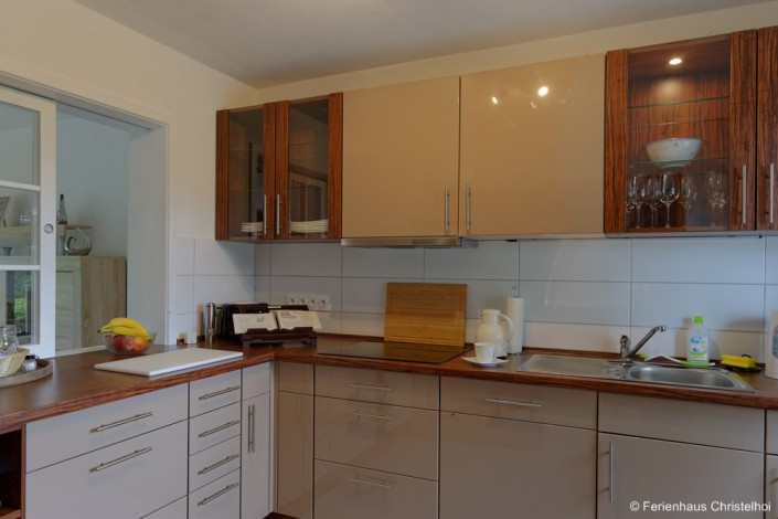 7.4 m² kitchen with service hatch to the living and dining area